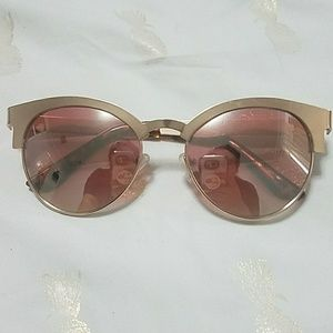 Rose gold sunglasses from Urban Outfitters